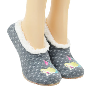 Shown on a leg form, these gray with subtle white specs women's slippers with soft fur lining by the brand K Bell feature a blonde mermaid lounging on the toe.