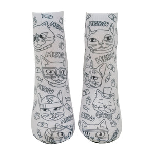 Shown from the front on a leg form, these fun white cotton socks with different silly cats on them come with Crayola fabric markets in purple, blue, pink and yellow to color in your own unique design.