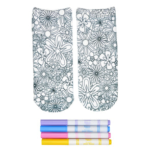 These white cotton socks with a beautiful floral design on them come with Crayola fabric markets in pastel purple, blue, pink and yellow to color in your own unique design.