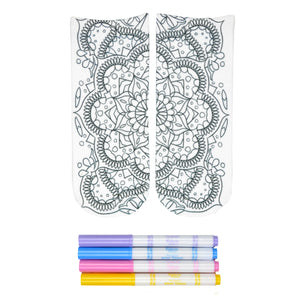 These white cotton socks with a beautiful mandala design on them come with Crayola fabric markets in pastel purple, blue, pink and yellow to color in your own unique design.