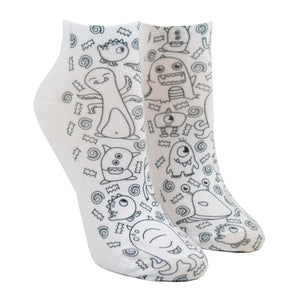 Shown on a leg form, these fun white cotton socks with different monsters on them come with Crayola fabric markets in red, orange, green and blue to color in your own unique design.