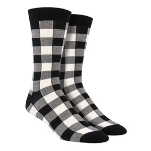 These comfortable men's crew socks are black and white plaid with a black cuff and toe and made of soft bamboo by the brand Socksmith.