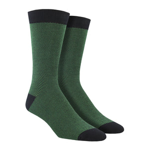 A green herringbone patterned bamboo men's crew sock by Socksmith is shown on a mannequin footform.