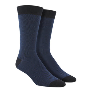 A blue men's bamboo herringbone crew sock by Socksmith is shown on a mannequin foot form.