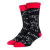 Math equations cover a black men's cotton crew sock by socksmith while being displayed on a mannequin foot form. .