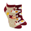 Shown on a leg form, these mismatched cotton ankle socks by the brand Many Mornings feature one socks that's tan with a maroon heel, toe and cuff that has chickens on it, and the other sock is maroon with fried eggs on it.