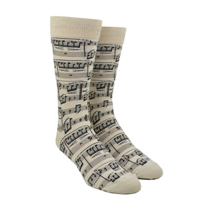 Sheet music covers a cream colored cotton men's sock by Modsock while displayed on a mannequin foot.