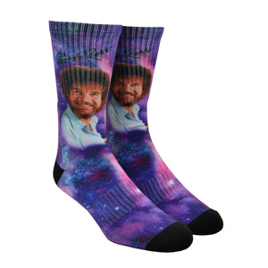 Artist Bob Ross is show floating through a purple galaxy on a unisex crew length sock by Good Luck socks.