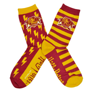 These red and yellow unisex novelty socks by the brand Out of Print feature the Harry Potter house crest for Gryffindor in front of lightening bolds on one sock and stripes on the other.