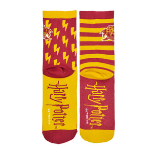 These red and yellow unisex novelty socks by the brand Out of Print feature the Harry Potter house crest for Gryffindor in front of lightening bolds on one sock and stripes on the other, with the Harry Potter logo on the foot.