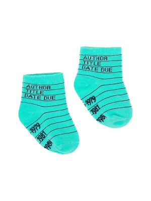 "These kid's cotton crew socks in green by the brand Out of Print feature the iconic library card design with the words ""Author, Title, Date Due"" written on the leg and a grid for filling in the information running down the leg and foot."
