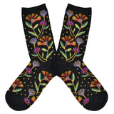 These black cotton women's crew socks by Socksmith feature the artwork of Laurel Burch and have pink, purple and orange flowers woven with metallic threads all over the leg and foot.