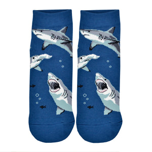 These blue cotton men's ankle socks by Socksmith feature great white sharks and hammerhead sharks swimming under the sea.