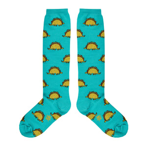 These blue cotton unisex knee high socks by the brand Sock It To Me feature dinosaurs with bodies that look like a taco.