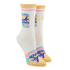 "Shown on a leg form, these white cotton cute women's crew socks with a peach toe and cuff by the brand Yellow Owl Workshop feature a can that says ""La Queen"" on one side, and two grapefruit, one sliced and one whole, on the other side, and near the toe there's peach, pink and light blue swirls that resemble the design of the La Croix can, bubbles and the words ""La Queen""."