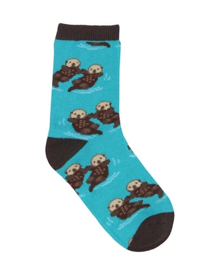 These blue cotton kid's crew socks with a brown heel, toe and cuff by the brand Socksmith feature adorable otters floating in the ocean holding hands.