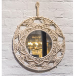 Macrame wall hanging with mirror