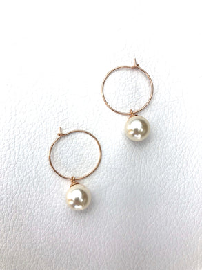 Pearl round drop on hoop.