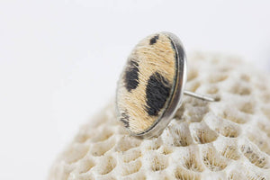 Fur stud earring with wild cat pattern. Image by Alex and Matt Creative.