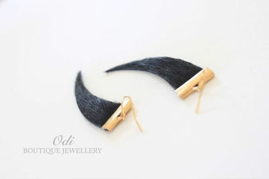 Leather tooth earring.