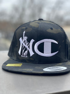 """NYC"" CAMO SNAP BACK ( WHITE TEXT )"