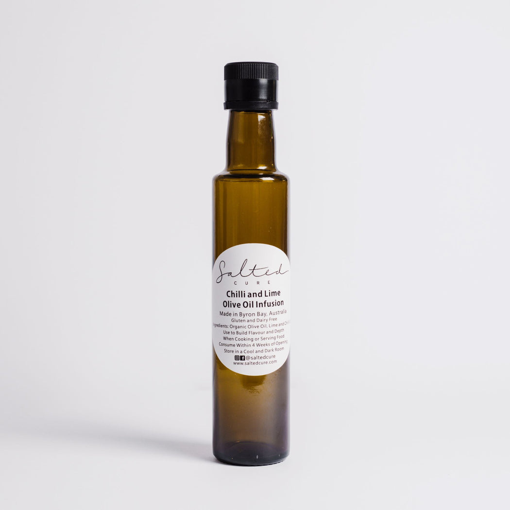 Gourmet oil infusion made in Byron Bay with local produce. Chilli and Lime Oil Infusion by Salted Cure is perfect when cooking meat, a gourmet gift, and to enhance the flavours of any meal.
