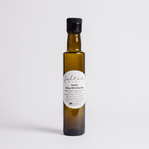 Gourmet oil infusion made in Byron Bay with local produce. Garlic Olive Oil Infusion by Salted Cure is perfect when cooking meat, a gourmet gift, and to enhance the flavours of any meal.