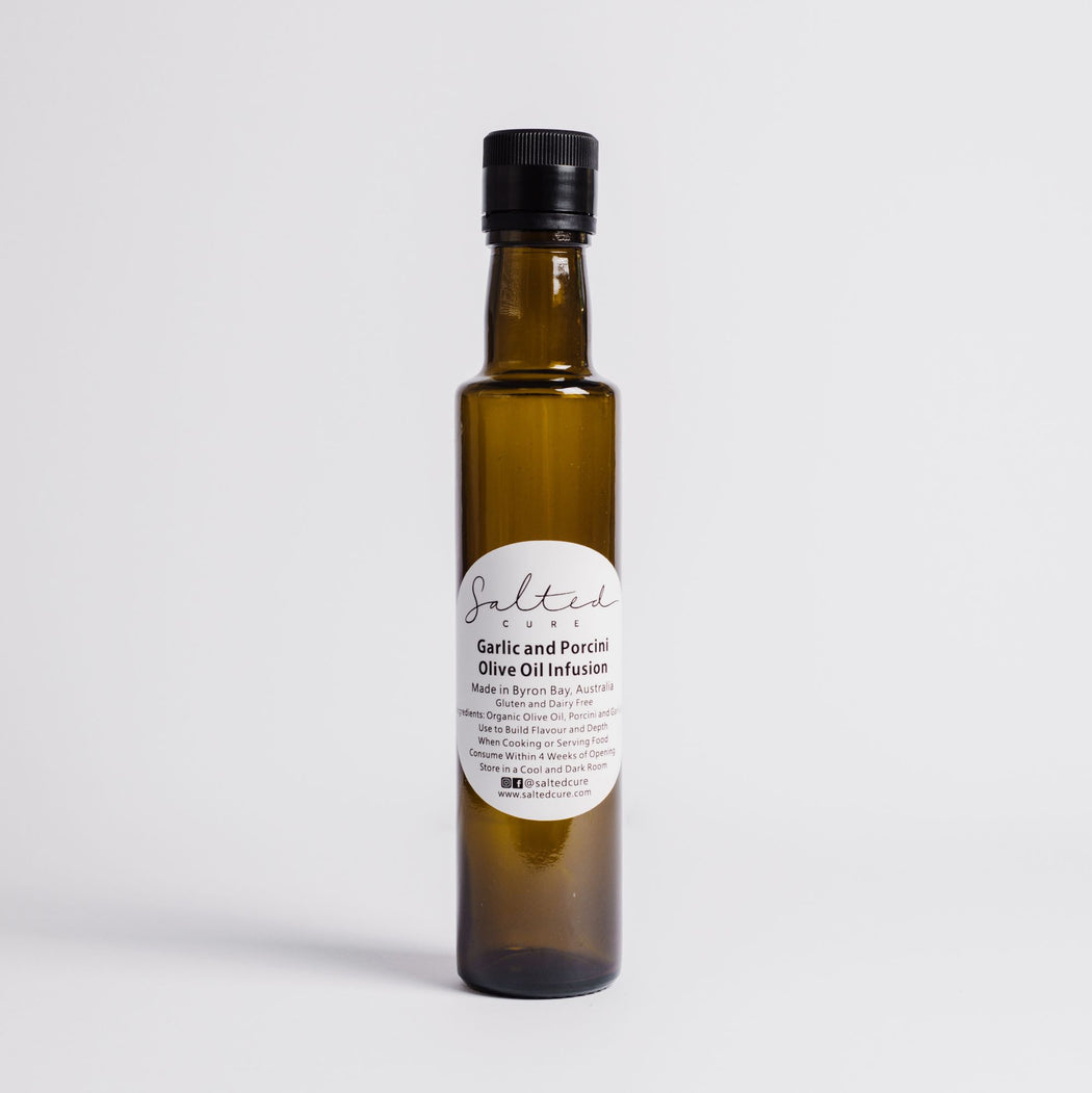 Gourmet oil infusion made in Byron Bay with local produce. Garlic & Porcini Olive Oil Infusion by Salted Cure is perfect when cooking meat, a gourmet gift, and to enhance the flavours of any meal.