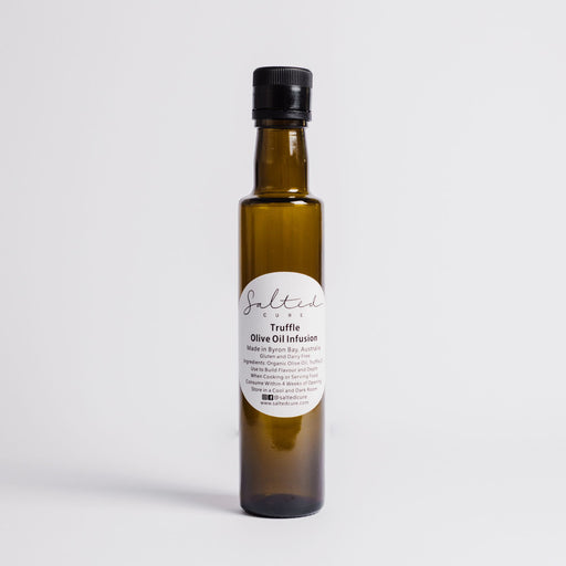 Gourmet oil infusion made in Byron Bay with local produce. Truffle Olive Oil Infusion by Salted Cure is perfect when cooking meat, a gourmet gift, and to enhance the flavours of any meal.