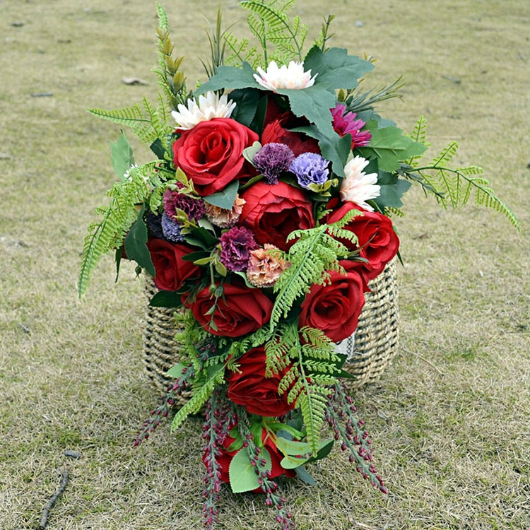 Red Rose Cascade Bouquet With Subtle Coloured Flowers Throughout. - weddingniknaks