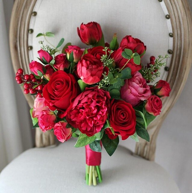 Red Rose Bouquet with Berries and Satin Ribbon Bound Around The Stems - weddingniknaks