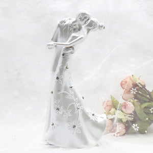 WEDDING CAKE TOPPER WITH KISSING BRIDE AND GROOM - weddingniknaks