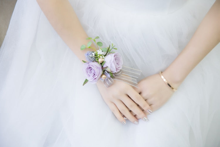 CO-CORDINATING LAVENDER BUTTON HOLES/CORSAGES AND WRIST CORSAGES. - weddingniknaks