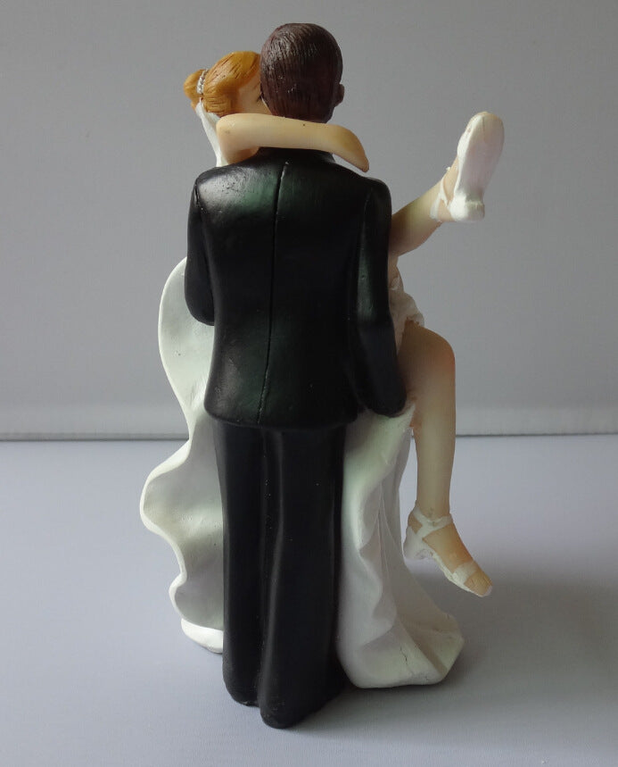 Resin Groom carrying his Bride Cake Topper. - weddingniknaks