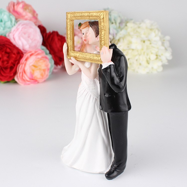 Bride and Groom Cake Topper, Posing With Picture Frame and Groom Kissing Bride - weddingniknaks