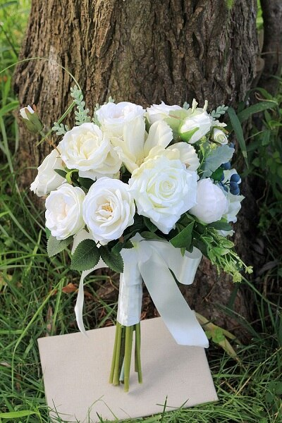 Stunning white flower bridal bouquet with delicate foliage to compliment - weddingniknaks