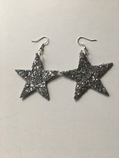 Silver glittery star shaped earrings