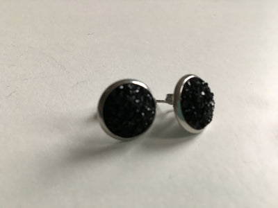 Black sparkly resin studs