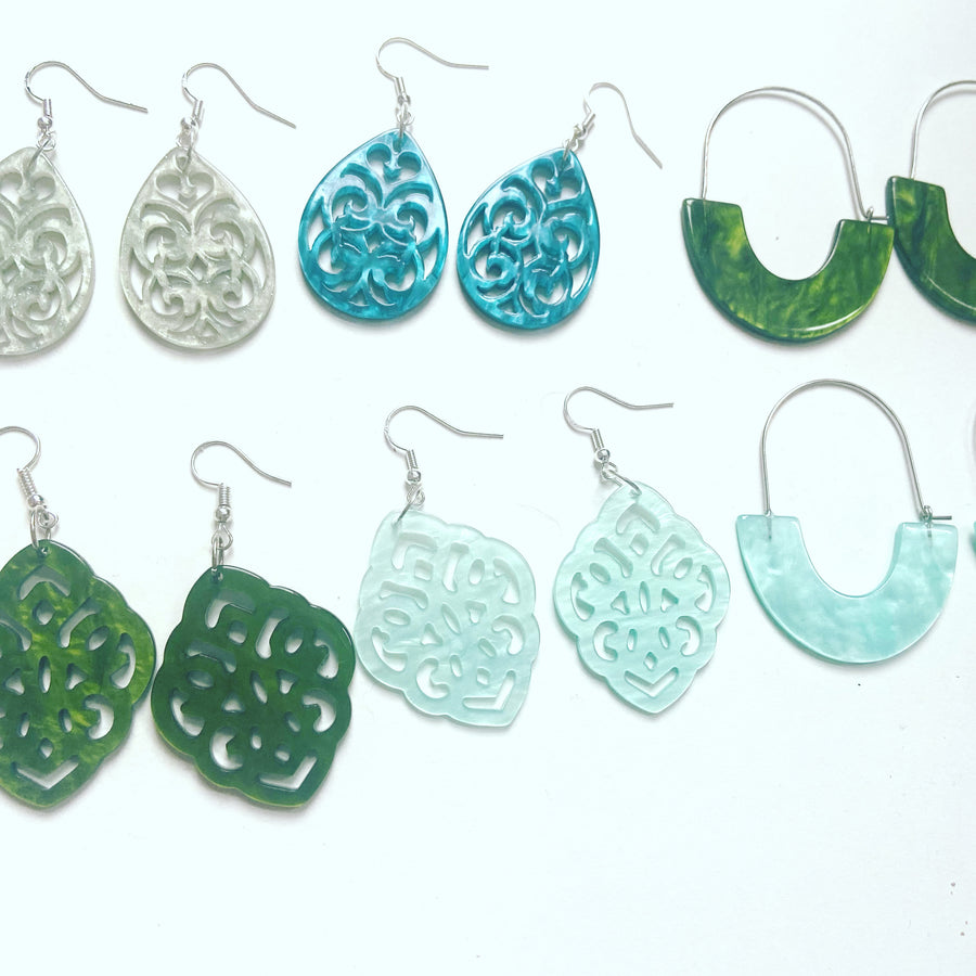 Light green tear shaped resin earrings