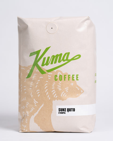 2.5 lb bag of Kuma Coffee, kraft brown bear with green logo, the coffee name Suke Quto and Ethiopia written in the lower right corner