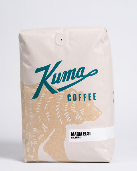 2.5 lb bag of Kuma Coffee, kraft brown bear with teal logo, the coffee name Maria Elsi and Colombia written in the lower right corner