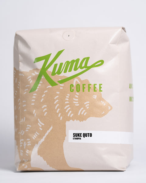 5lb bag of Kuma Coffee, kraft brown bear with green logo, the coffee name Suke Quto and Ethiopia written in the lower right corner