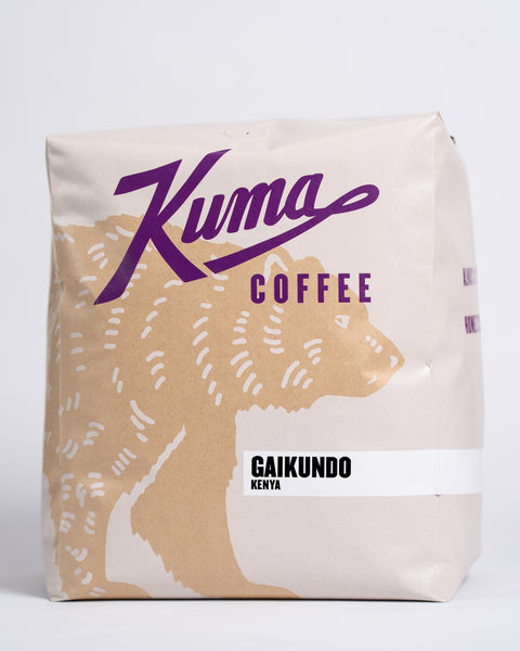 5lb bag of Kuma Coffee, kraft brown bear with purple logo, the coffee name Gaikundo and Kenya written in the lower right corner