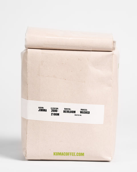 12oz retail bag of Agaro Dera washed coffee from Jimma, Ethiopia, grown between 2000 and 2100 meters, washed processed coffee with the Heirloom varietal  roasted by Kuma Coffee in Seattle, WA