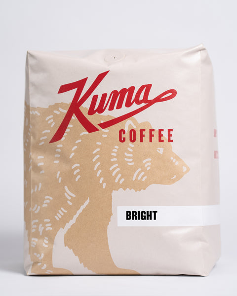 5lb bag of Kuma Coffee, kraft brown bear with red logo, the coffee name Bright written in the lower right corner