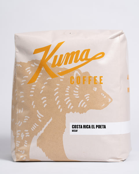 5lb bag of Kuma Coffee, kraft brown bear with orange logo, the coffee name Costa Rica El Poeta, Decaf written in the lower right corner