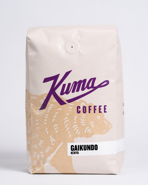 2.5 lb bag of Kuma Coffee, kraft brown bear with purple logo, the coffee name Gaikundo and Kenya written in the lower right corner