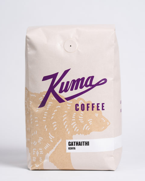 2.5 lb bag of Kuma Coffee, kraft brown bear with purple logo, the coffee name Gathaithi and Kenya written in the lower right corner