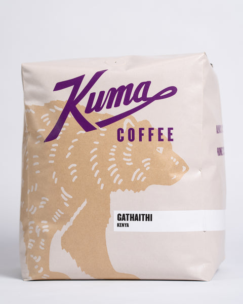 5lb bag of Kuma Coffee, kraft brown bear with purple logo, the coffee name Gathaithi and Kenya written in the lower right corner