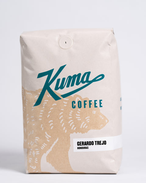 2.5 lb bag of Kuma Coffee, kraft brown bear with teal logo, the coffee name Gerardo Trejo written in the lower right corner